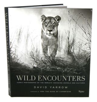 Wild encounters: iconic photographs of the world's vanishing animals and cultures. David Yarrow